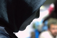 Close-up Of Mannequin Wearing Hooded Shirt At Store