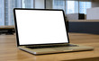 laptop with blank space on wooden table in the office and bokeh background