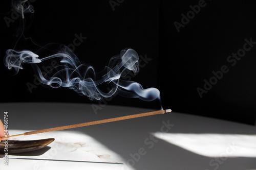 Valokuva smoke incense stick on black background home meditation anti stress concept