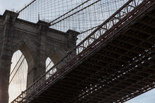 Brooklyn Bridge, Side View Of Part Of The Bridge And One Of The Arches