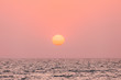 Leinwanddruck Bild - Natural Color Sunset Sunrise Sky Over Sea. Seascape With Shining Setting Sun On Sea Horizon