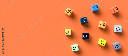 many cubes with speech bubble icons on orange background Fotobehang