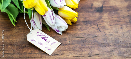 Fotografia, Obraz Thank you background banner - Bunch Bouquet of colorful tulips and wooden label