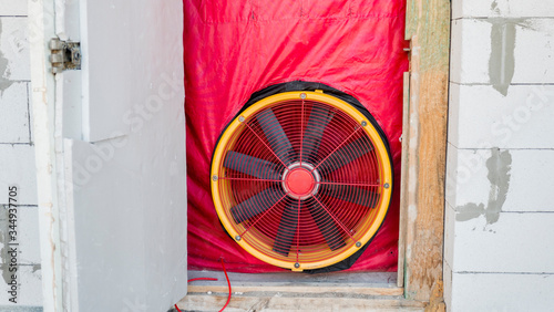 Photo Blower door test: Testing the house for airtightness, on the front door installed a powerful fan
