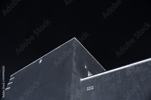the outline of the building is accentuated at night Canvas Print