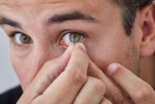 Man Inserting Contact Lens