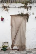 Fishing Net Covering A Doorway