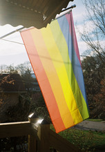 Rainbow Flag In The Porch Of A...