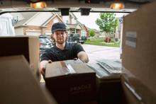 Shipment: Man Getting Boxes Ou...