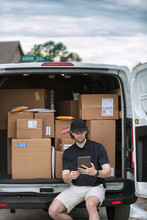 Shipment: Man Sits On Bumper T...