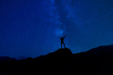 Victorious Silhouette Under Stars And Milky Way Night Skies In Summer