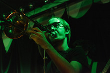 Portrait Of A Young Male Trombone Musician On Stage
