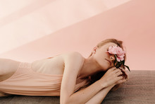 Young Woman With Flower Restin...