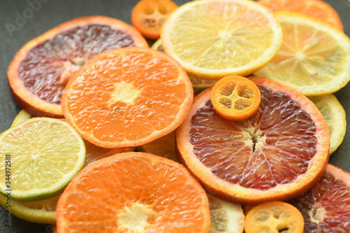 Ripe red orange lemon kumquat lime thin slices