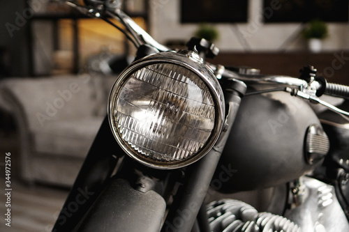 Fototapeta Motorcycle close-up in the room. Photo from the studio