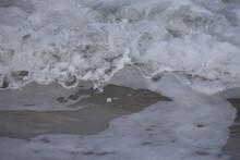 Sea Foam Cresting Over Wave