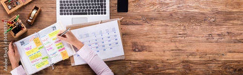 Businesswoman Writing Schedule In Calendar Diary Canvas Print