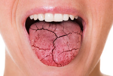 Woman Showing Tongue Over Whit...