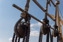 Block And Tackle Rigging On An Old Tall Ship Before Blue Sky, Spliced And Wrapped Rope Lines, Horizontal Aspect