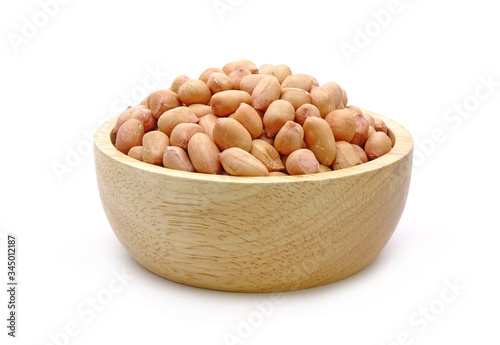 Peanut in wooden bowl isolated on white background, in traditional Chinese medic Wallpaper Mural