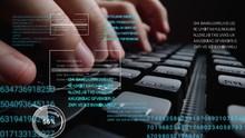 Man Working On Laptop Computer...