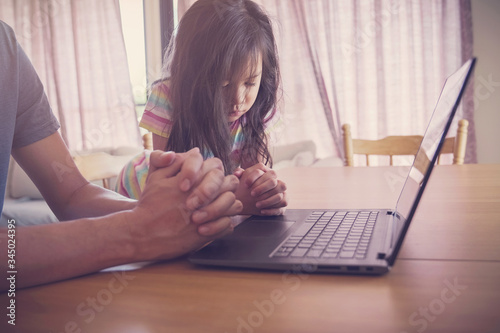 Child praying with father parent with laptop, family and kids worship online tog Fototapet