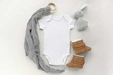 Blank Gender Neutral White Baby Bodysuit Close Up - With Toy  And Brown Booties - Newborn Apparel Mockup