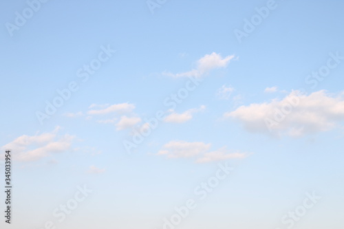 Fototapeta Pale blue sky and clouds  - 淡い色の空と雲