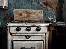 Old Stove In The Kitchen Of An Abandoned Building