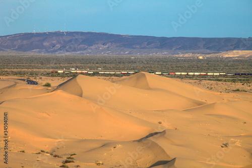 Desert Dunes with Freight Train