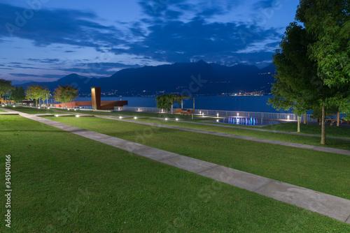 Modern lakeside promenade at dusk Canvas Print