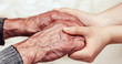 canvas print picture - Helping hands. Care for the elderly. Young woman holding hands with a senior lady