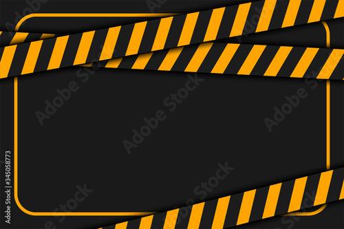 Fototapeta warning or caution tape on black background