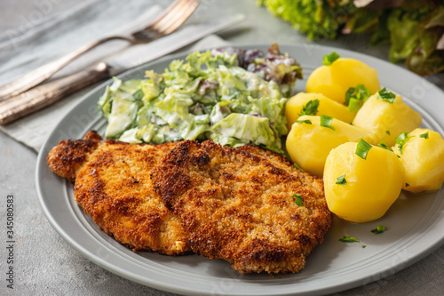 Chop pork cutlets , served with boiled potatoes and salad. Wallpaper Mural