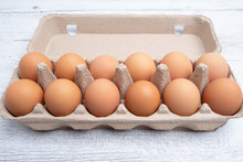 Dozen Eggs In Cardboard Package Closeup