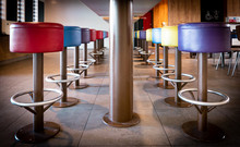 Colored Chairs Stand In A Row ...