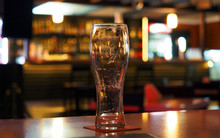 Evening. Empty Beer Glass On T...