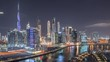 Aerial panoramic view of canal in the city at bright night near with luxury buildings canal in Business Bay timelapse with Downtown skyscrapers, Dubai, United Arab Emirates