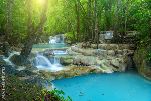 Fotografering Beautiful waterfall in deep forest at Erawan National Park, Thailand