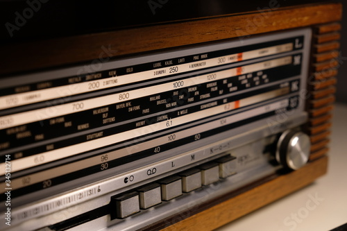 Tuning an old vintage analogic wooden radio dial Wallpaper Mural