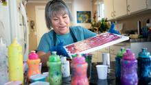Senior Woman Creating Art In H...