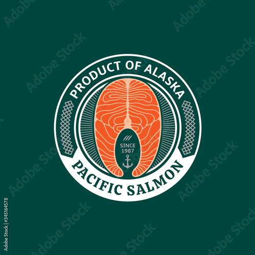 Photo Vector Alaskan salmon logo on a green background