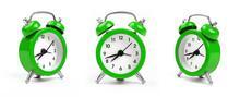 Three Green Alarm Clock Over White