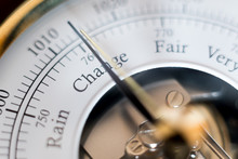 Needle Of A Barometer Pointing At The Word Change. Close Up Of The Word