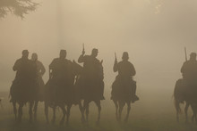 Group Of Silhouetted Soldiers On Horseback With Guns In The Air Moving Forward In The Smokey Haze Toward The Battle In The American Civil War