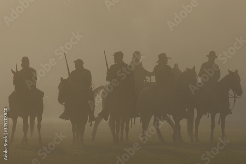 Fotografija American Civil War horseback riders prepare to advance in battle