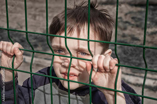 Refugees child  near the border fence Canvas Print