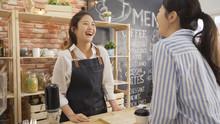 Cheerful Female Waiter Taking ...