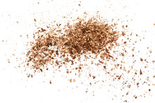 Small Wooden Shavings Of Sawdust On A White Background.
