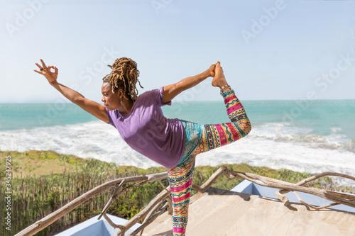 Beautiful Black Woman Doing Yoga on Tropical Beach Canvas Print